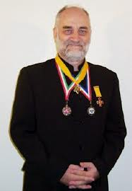 Prince Ronald with medals of Orders Vytis, St Andrew, and Rizal