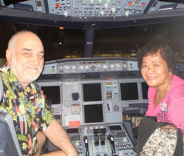 King Roman and Lady Fele in cockpit of an Airbus 320
